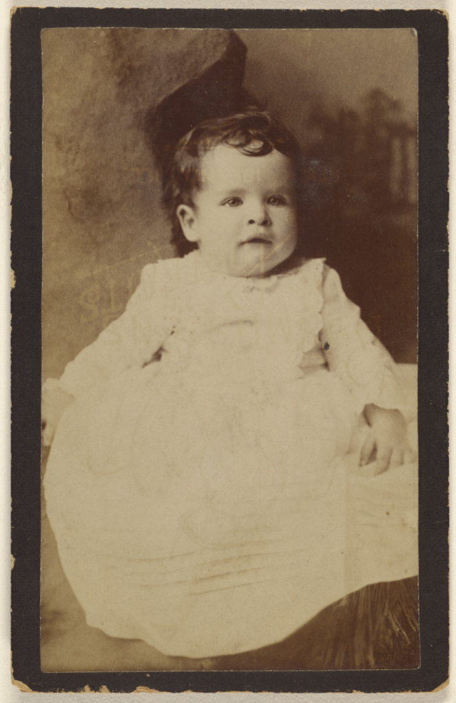 [Unidentified baby, seated]; Gustav A. Flach (American, active 1860s); about 1880; Albumen silver print; 84.XD.1157.1488; The J. Paul Getty Museum, Los Angeles; Rights Statement: No Copyright - United States