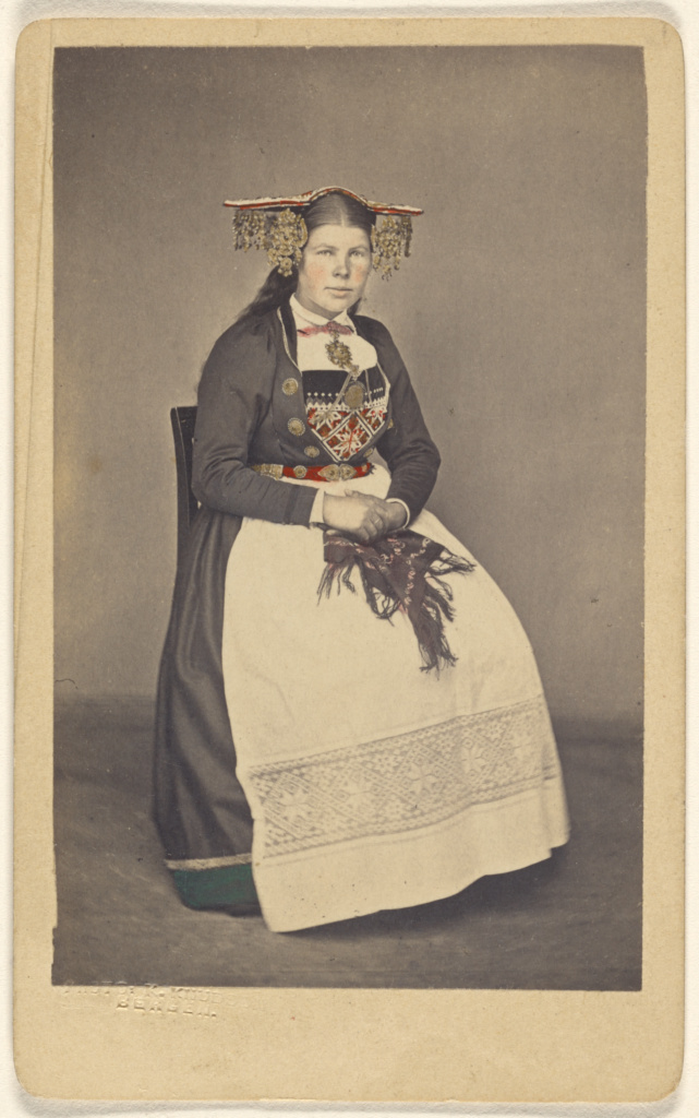 Brud fra Vos. [woman in traditional Norwegian costume]; Knud Knudsen (Norwegian, 1832 - 1915, active Bergen, Norway); July 1, 1870; Hand-colored albumen silver print; 84.XD.1157.2225; The J. Paul Getty Museum, Los Angeles; Rights Statement: No Copyright - United States
