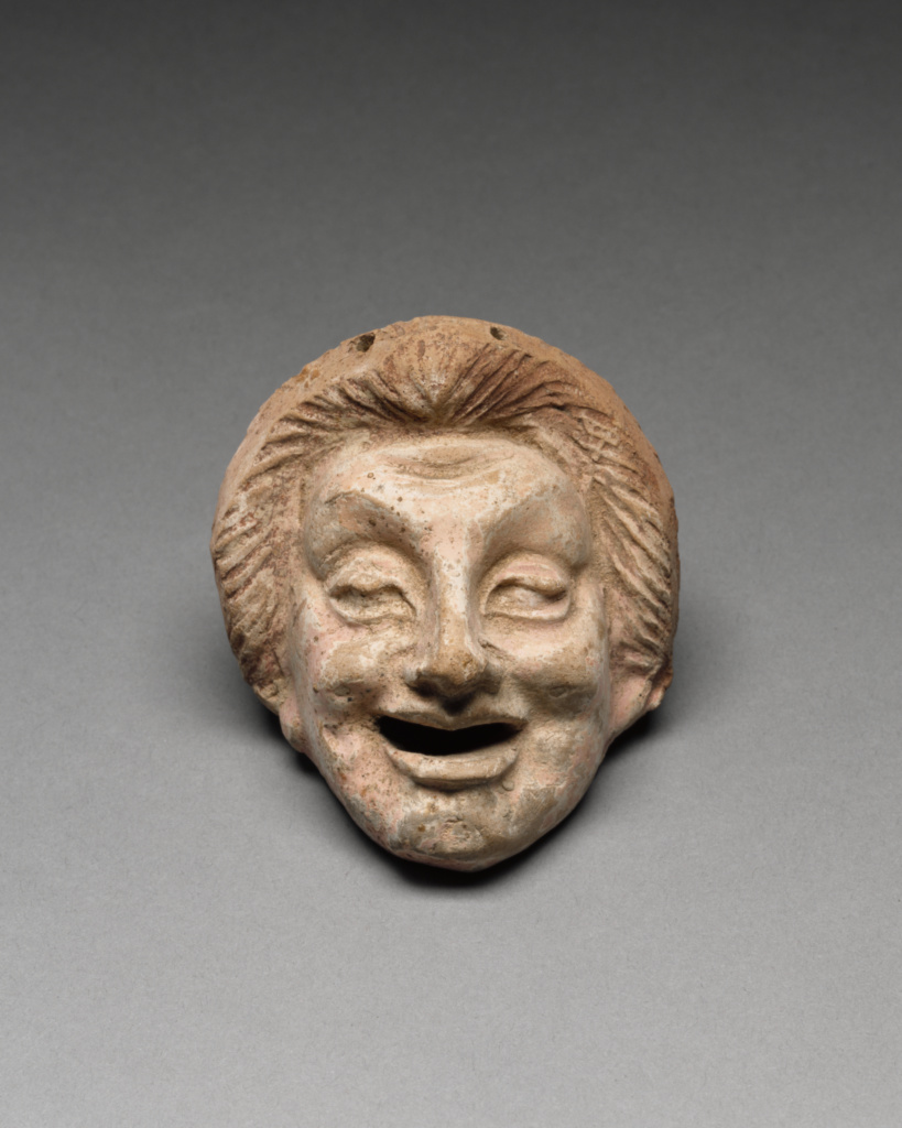 Comic Mask; Unknown; 300–200 B.C.; Terracotta with white slip and polychromy (brownish red, pink); 9 × 8.4 × 9 cm (3 9/16 × 3 5/16 × 3 9/16 in.); 96.AD.247; Gift of Barbara and Lawrence Fleischman; Rights Statement: No Copyright - United States