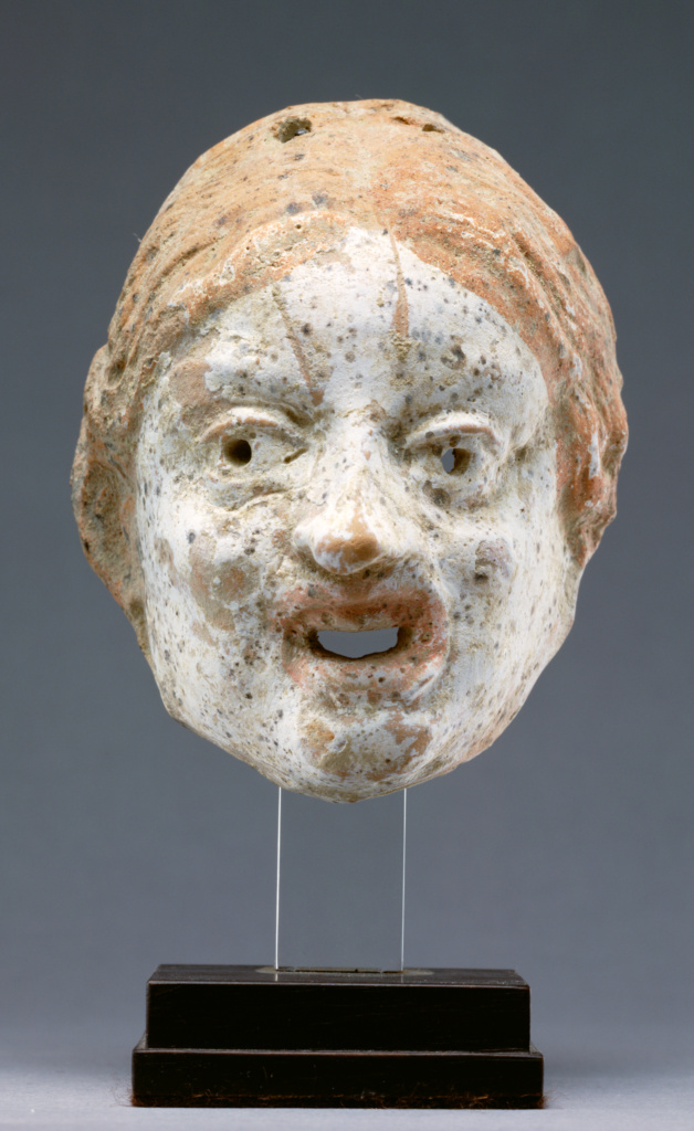 Miniature Theatrical Mask of a Woman; Unknown; Eastern Mediterranean; 3rd century B.C.; Terracotta with polychromy; 9 × 5.5 cm (3 9/16 × 2 3/16 in.); 96.AD.263.2; The J. Paul Getty Museum, Villa Collection, Malibu, California, Gift of Barbara and Lawrence Fleischman; Rights Statement: In Copyright; Image: Bruce White Photography