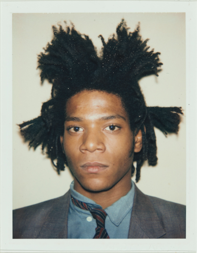 [Portrait of Jean-Michel Basquiat]; Andy Warhol (American, 1928 - 1987); 1982; Polaroid dye diffusion print; 9.5 × 7.3 cm (3 3/4 × 2 7/8 in.); 98.XM.168.6; Rights Statement: In Copyright; Copyright: © The Andy Warhol Foundation for the Visual Arts, Inc.