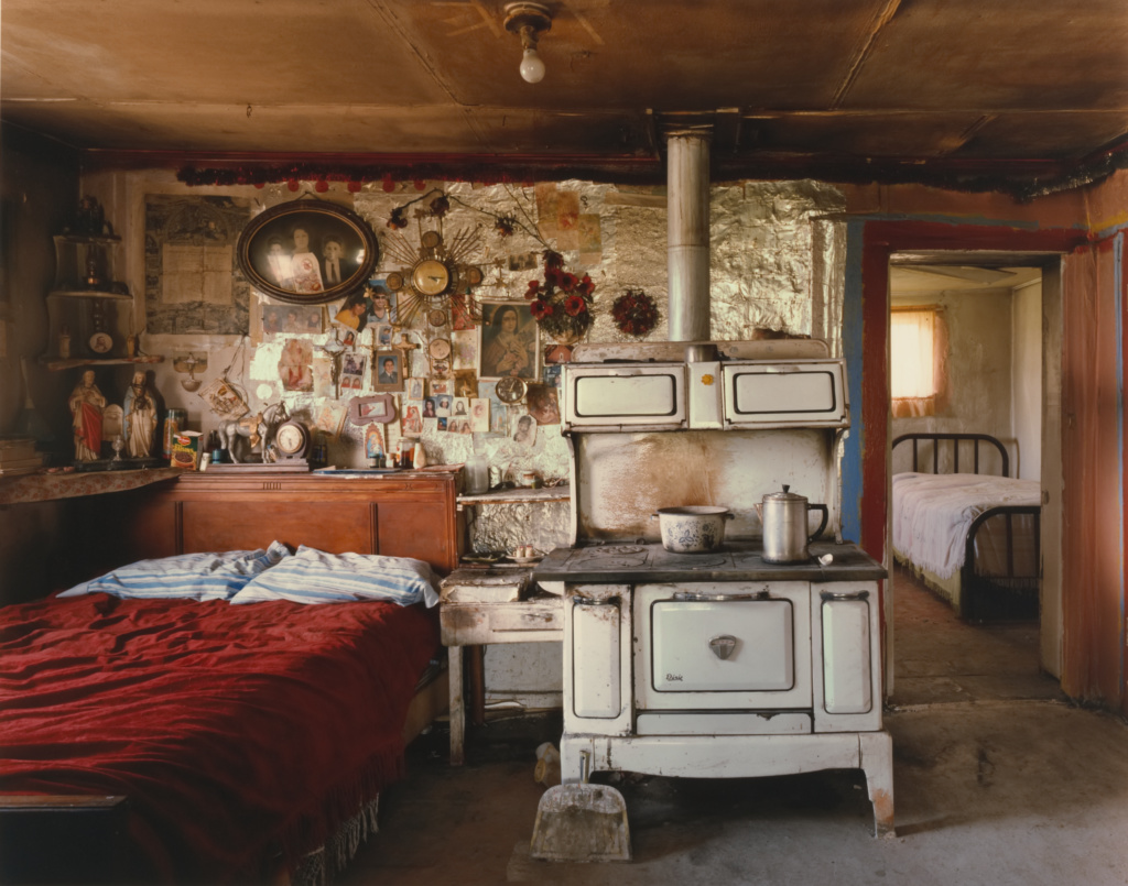 Amadeo Sandoval's Kitchen and Bedroom, Río Lucío, New Mexico; Alex Harris (American, born 1949); Río Lucío, New Mexico, United States; negative June 1985; print 1994; Chromogenic print; 44.6 × 56.8 cm (17 9/16 × 22 3/8 in.); 98.XM.214.3; The J. Paul Getty Museum, Los Angeles, Gift of Nancy and Bruce Berman; Rights Statement: In Copyright; Copyright: © Alex Harris