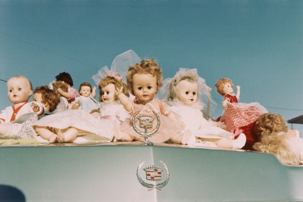 Dolls on Cadillac, Memphis; William Eggleston (American, born 1939); 1972; Chromogenic print; 25.4 × 38.1 cm (10 × 15 in.); 99.XM.21.5; Rights Statement: In Copyright; Copyright: © Eggleston Artistic Trust