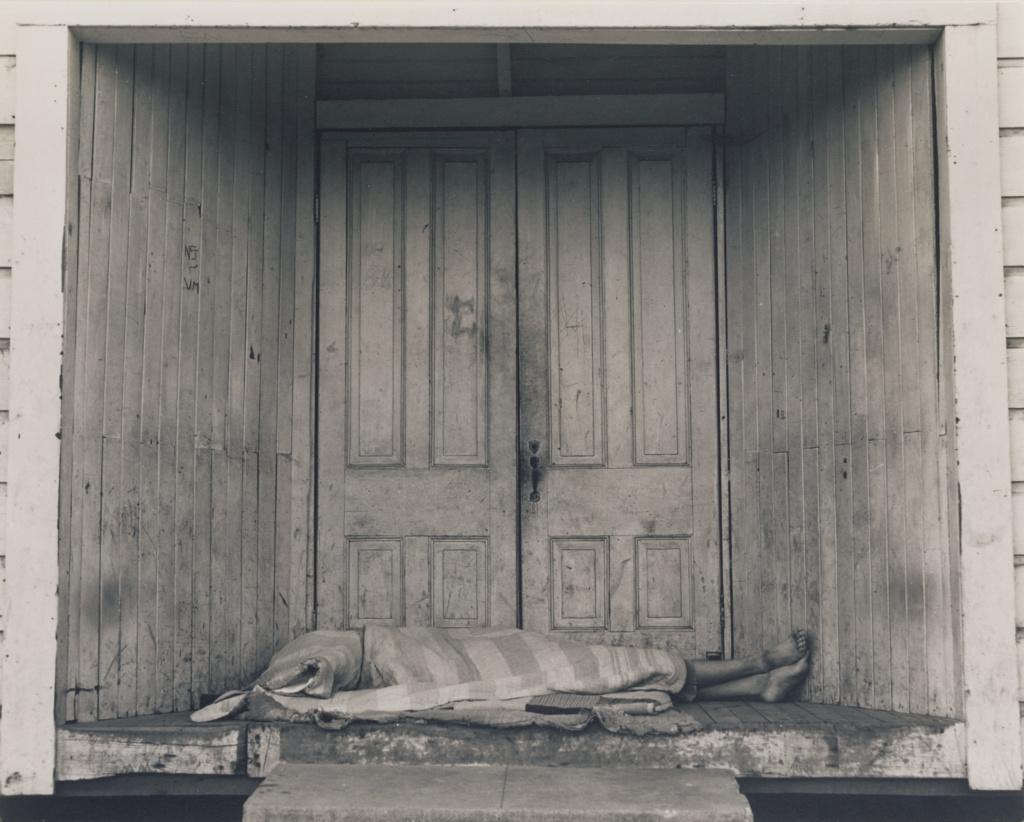 Grayson, California / Doorstep Document / Death in the Doorway; Dorothea Lange (American, 1895 - 1965); Grayson, California, United States; negative 1938; print about 1950s; Gelatin silver print; 18.5 × 23.3 cm (7 5/16 × 9 3/16 in.); 2000.43.3; The J. Paul Getty Museum, Los Angeles; Rights Statement: In Copyright; Copyright: © Oakland Museum of California, the City of Oakland