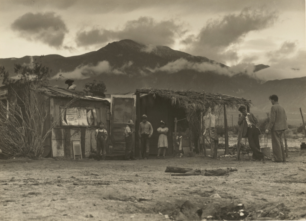 Paul Taylor with Migrant Workers, Imperial Valley, California; Dorothea Lange (American, 1895 - 1965); 1935; Gelatin silver print; 17.8 × 24.1 cm (7 × 9 1/2 in.); 2000.43.2; The J. Paul Getty Museum, Los Angeles; Rights Statement: No Copyright - United States