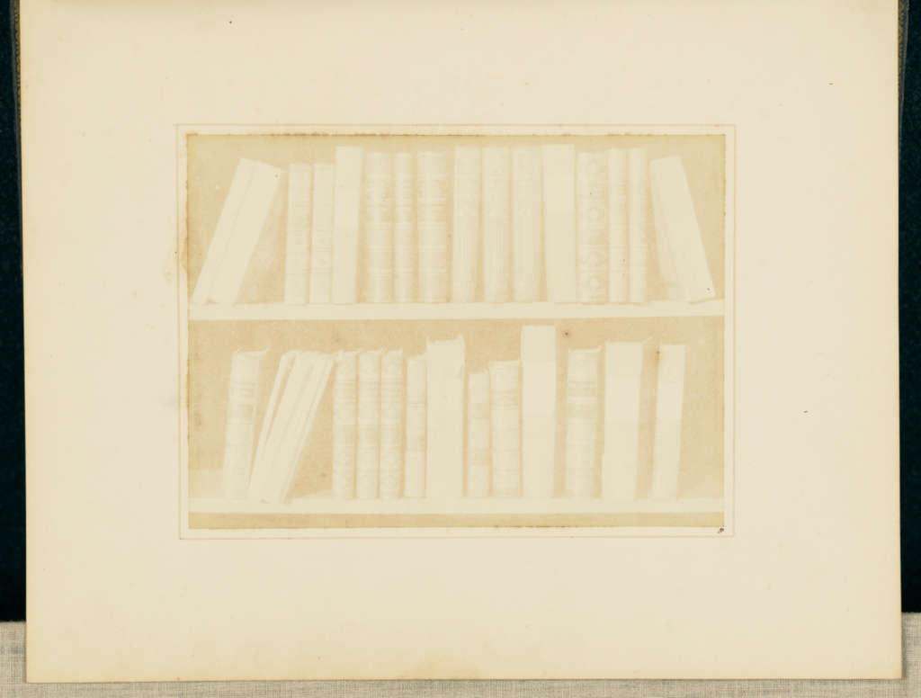 A Scene in a Library; William Henry Fox Talbot (English, 1800 - 1877); Reading, England; 1844; Salted paper print; 13.1 × 17.8 cm (5 3/16 × 7 in.); 84.XZ.572.8; The J. Paul Getty Museum, Los Angeles; Rights Statement: No Copyright - United States