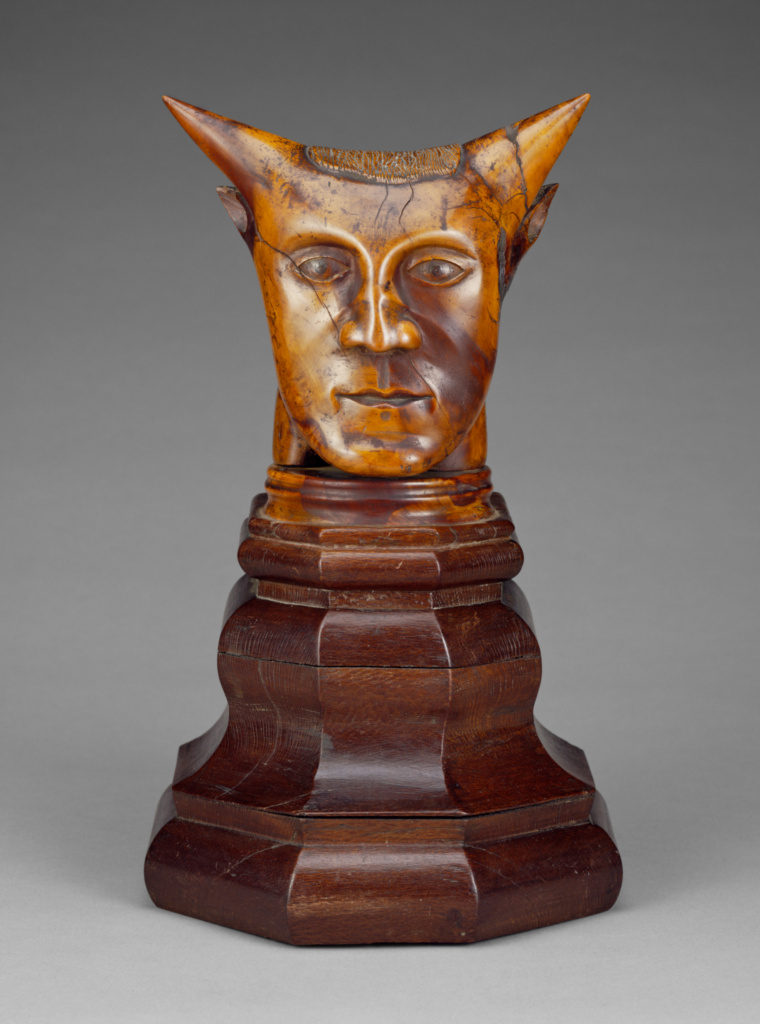 Head with Horns; Unknown; before 1894; Sandalwood with traces of polychromy on a lacewood base; 22 × 22.8 × 12 cm (8 11/16 × 9 × 4 3/4 in.); 2002.18; The J. Paul Getty Museum, Los Angeles; Rights Statement: No Copyright - United States