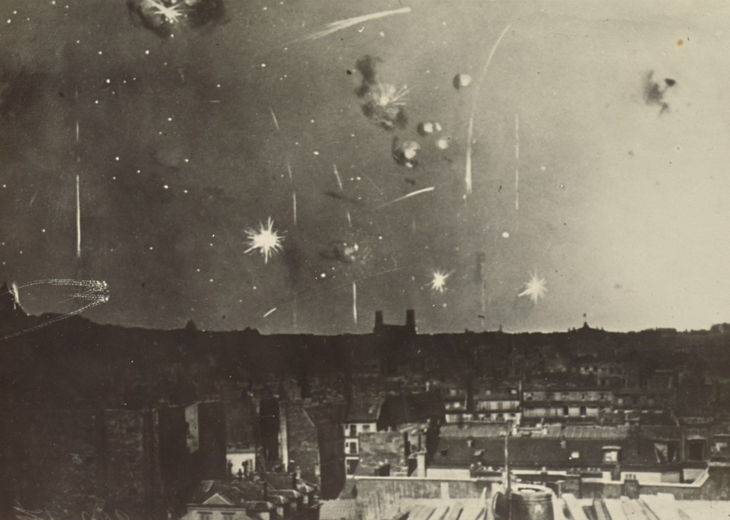 [Bombs over low buildings]; Fédèle Azari (Italian, 1895 - 1930); Paris, France; 1914 - 1919; Gelatin silver print; 11.8 × 12.3 cm (4 5/8 × 4 13/16 in.); 84.XA.240.47; The J. Paul Getty Museum, Los Angeles; Rights Statement: No Copyright - United States