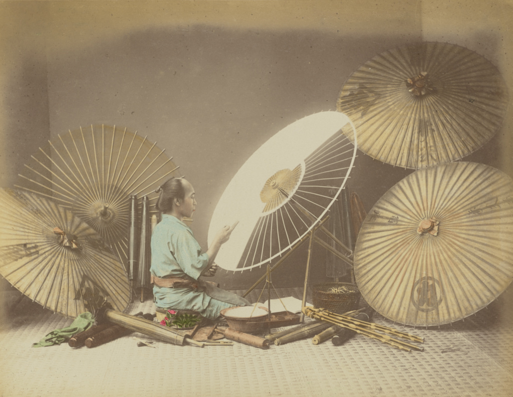 Umbrella Maker; Kusakabe Kimbei (Japanese, 1841 - 1934); Japan; 1870s–1890s; Hand-colored albumen silver print; 20.3 × 26.6 cm (8 × 10 1/2 in.); 84.XA.700.4.37; The J. Paul Getty Museum, Los Angeles; Rights Statement: No Copyright - United States