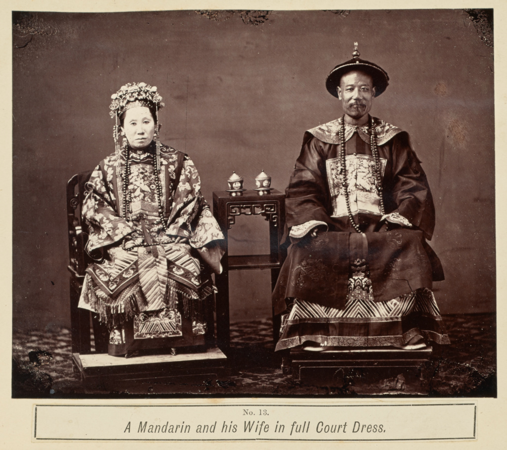 A Mandarin and his Wife in Full Court Dress; Attributed to Milton M. Miller (American, 1830 - 1899); Canton, China; 1861–1864; Albumen silver print; 15.9 × 19.7 cm (6 1/4 × 7 3/4 in.); 84.XA.755.7.180; The J. Paul Getty Museum, Los Angeles; Rights Statement: No Copyright - United States