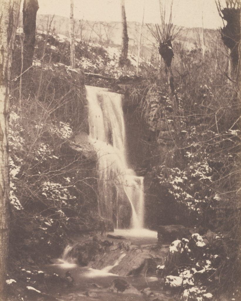 [Forest Scene with Waterfall and Stream]; Unknown maker, French, Louis Désiré Blanquart-Evrard (French, 1802 - 1872); Lille, France; 1853; Salted paper print; 22.2 × 17.9 cm (8 3/4 × 7 1/16 in.); 84.XO.1279.11; The J. Paul Getty Museum, Los Angeles; Rights Statement: No Copyright - United States