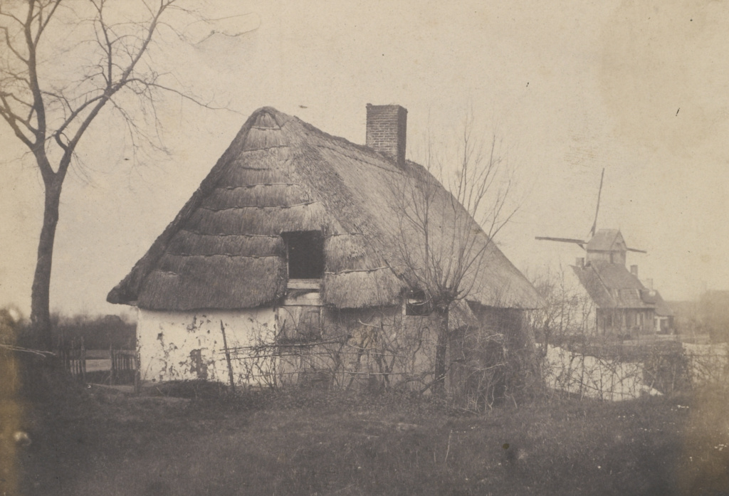 [Thatched-roof Building with Windmill]; Unknown maker, French, Louis Désiré Blanquart-Evrard (French, 1802 - 1872); Lille, France; 1853; Salted paper print; 14.4 × 21.1 cm (5 11/16 × 8 5/16 in.); 84.XO.1279.24; The J. Paul Getty Museum, Los Angeles; Rights Statement: No Copyright - United States
