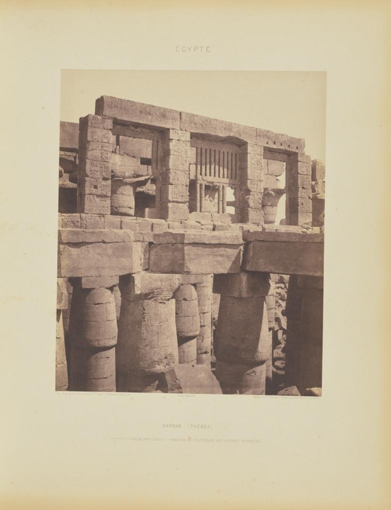 Karnak (Thèbes). Palais - Salle Hypostyle - Fenêtre et Chapiteaux des Galeries Latérales; Félix Teynard (French, 1817 - 1892); Karnak, Egypt; negative 1851–1852; print 1853; Salted paper print; 30.6 × 25.2 cm (12 1/16 × 9 15/16 in.); 86.XB.693.1.57; The J. Paul Getty Museum, Los Angeles; Rights Statement: No Copyright - United States
