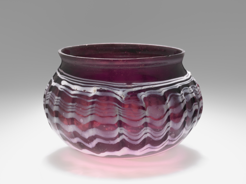 Burgundy Ribbed Bowl (Rippenschale) with White Trails; Unknown; second half of 1st century B.C.; Glass; 6.5 × 8.1 cm (2 9/16 × 3 3/16 in.); 2004.20; Rights Statement: No Copyright - United States