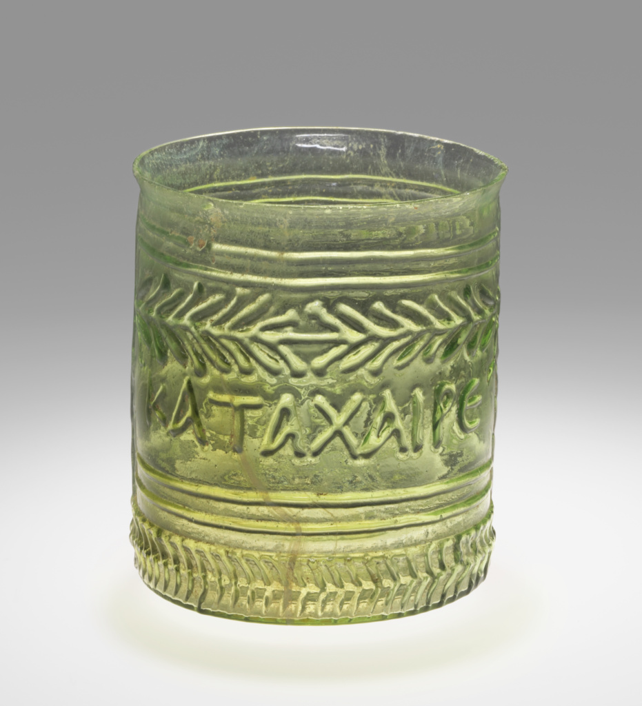 Beaker with Inscription; Unknown; Eastern Mediterranean; 1st century A.D.; Glass; 7.8 × 7.3 cm (3 1/16 × 2 7/8 in.); 2004.35; The J. Paul Getty Museum, Villa Collection, Malibu, California; Rights Statement: No Copyright - United States