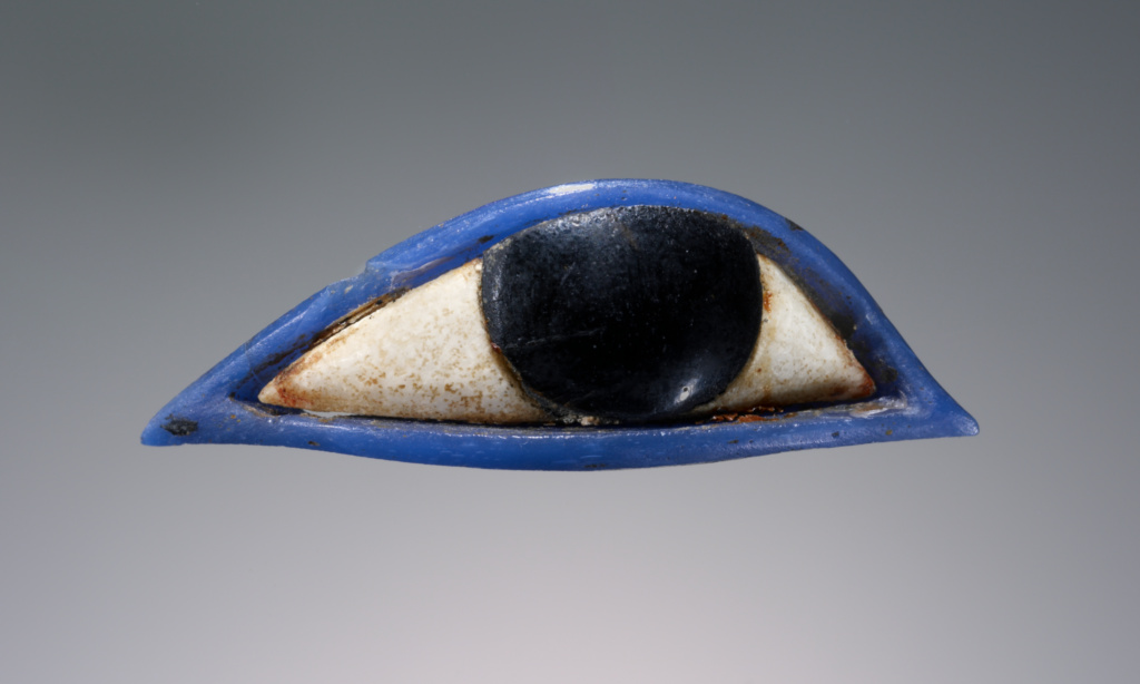 Inlay in the Form of an Eye; Unknown; 1540–1070 B.C.; Glass and gypsum; 1.4 × 4.6 × 1 cm (9/16 × 1 13/16 × 3/8 in.); 2003.154; Rights Statement: No Copyright - United States