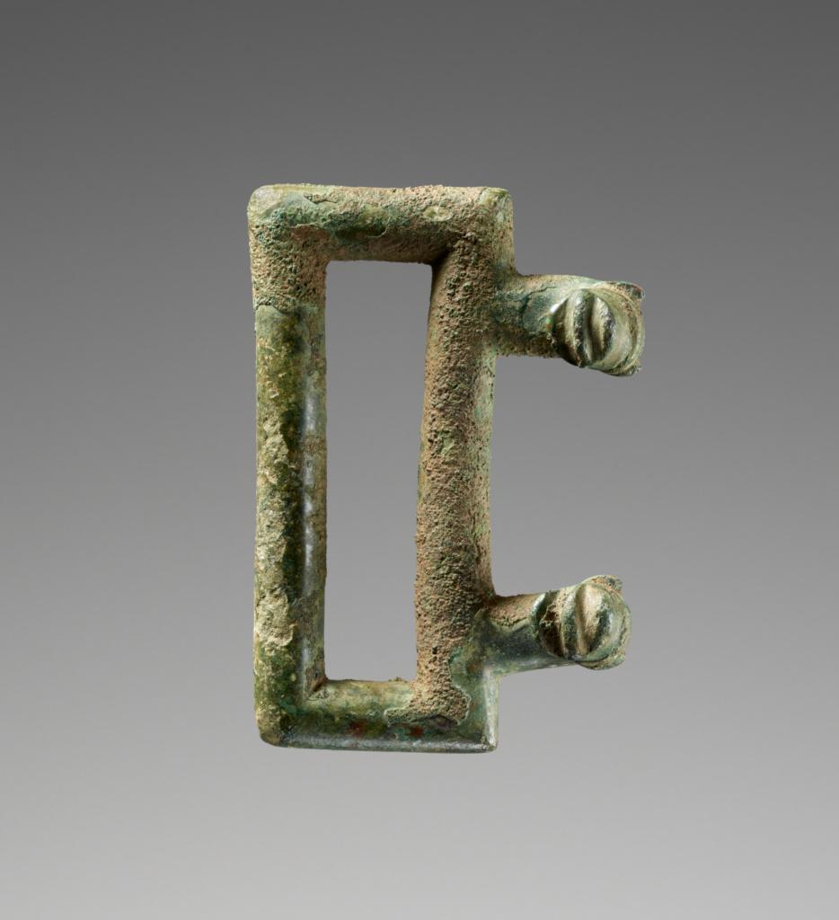 Belt Buckle; Unknown; Etruria; 700–650 B.C.; Bronze; 6.5 × 4.4 cm (2 9/16 × 1 3/4 in.); 75.AC.33.1; The J. Paul Getty Museum, Villa Collection, Malibu, California; Rights Statement: No Copyright - United States