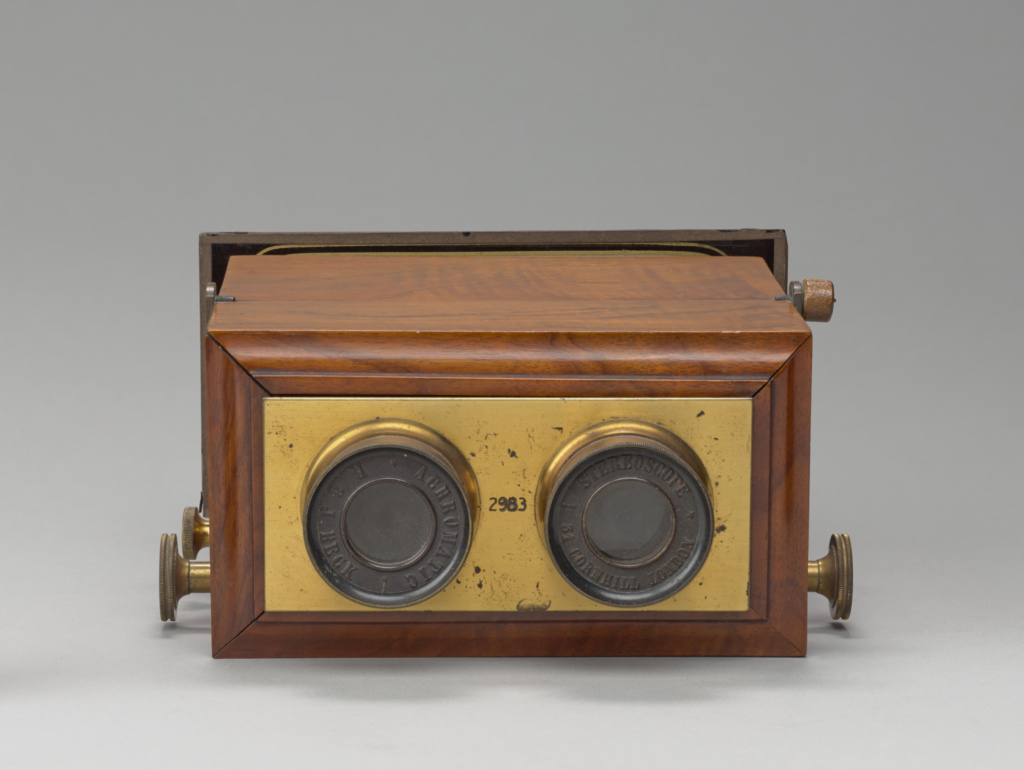Stereoscope (reversible in box); R. & J. Beck (British, founded 1865, dissolved 1891), Unknown maker, French; London, England; after 1865; Wood, brass, glass; 8.3 × 17.8 × 17.1 cm (3 1/4 × 7 × 6 3/4 in.); 2008.89.26; The J. Paul Getty Museum, Los Angeles, Gift of Gloria and Stanley Fishfader; Rights Statement: No Copyright - United States