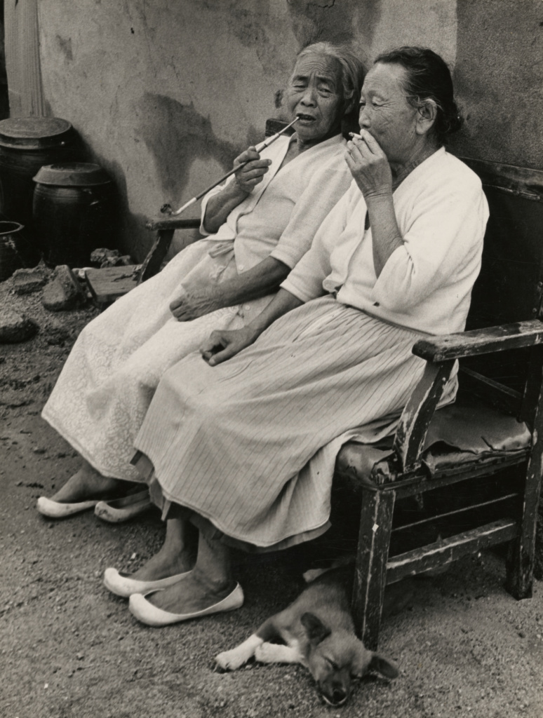 Two Seated Women Smoking; Ki-chan Kim (South Korean, 1938 - 2005); South Korea; September 2, 1974; Gelatin silver print; 21.9 × 16.6 cm (8 5/8 × 6 9/16 in.); 2011.80.2; The J. Paul Getty Museum, Los Angeles, Gift of Ki Chan Kim / Kyung Ja Choi; Rights Statement: In Copyright; Copyright: © Kyung Ja Choi for the Estate of Kim Ki-chan